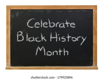 Celebrate Black History Month written in white chalk on a black chalkboard isolated on white