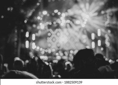 Celebrate carnival party , Blurry night club party music dancing sound , Party People Blurred Background. Black and white picture.