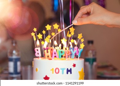 I celebrate my tenth birthday and light the cake.