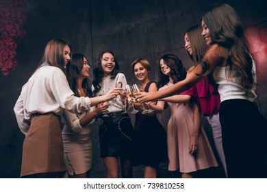 Celebrate New Year party. Company of beautiful girls with glasses of champagne celebrate New Year and happy smiling.