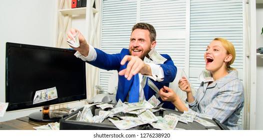Celebrate profit. Easy profit business tips. Man and woman cheerful happy colleagues throw up dollar banknotes. Profit and richness concept. Businessman hold cash dollars. Huge profit concept.