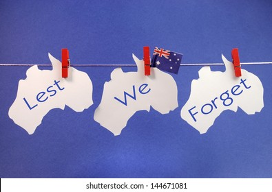 Celebrate Remembrance, November 11, or Anzac Day, April 25,  public holiday with a bright and vivid pegs on a line message greeting across three white Australian maps with an Aussie flag.