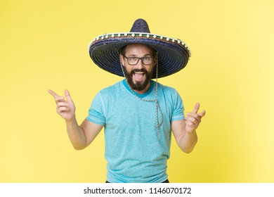 Celebrate traditions. Man on smiling face in sombrero hat celebrating, yellow background. Guy with beard looks festive in sombrero. Fest and holiday concept. Man in festive mood at party celebrating.