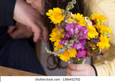 celebrate the victim feast of the elders on the religious holidays.happy mother and teachers day.kiss the mum hand.woman and kid hold the yellow daisy.