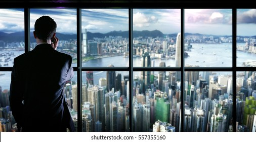 celebrates a successful young man on the tops of a glass building with wall street scenery and success with the work