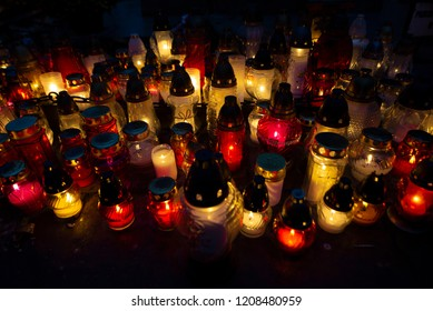 Celebrating All Saints Day. Sea of red and yellow candles glowing in the night.