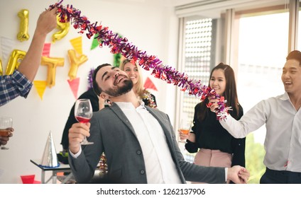 Celebrating Chrismas New Year Party , Caucasian Man Enjoy Limbo Dancing and Drinking with Friends in Event Cheerful Party