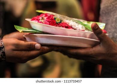 Celebrating Eid al fitr offering flowers at dargah.