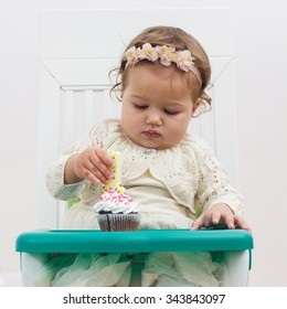 Celebrating First Birthday , portrait of cute little girl with cake.