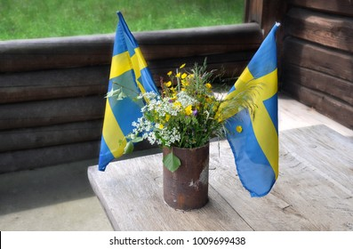 Celebrating Midsummer in Sweden (Midsommar). Bouquet for the dinner table. The swedish flag, Cow Parsleys and Buttercups is included.