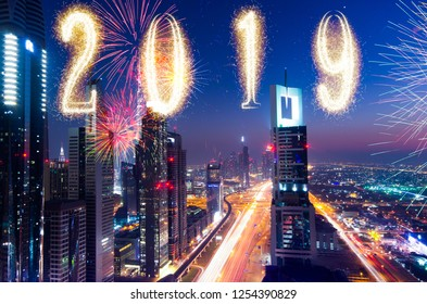 celebrating new yar 2019 in dubai, modern concept, skyscraper and firewors, travel concept