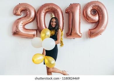 Celebrating. New Year 2019. Woman with balloons having fun.