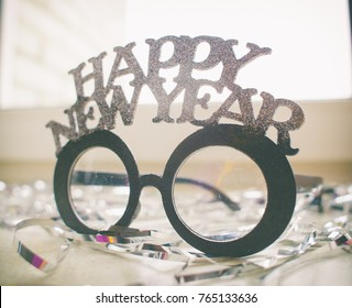 Celebrating new year, funny style background on white .  with golden glitters, copy space.