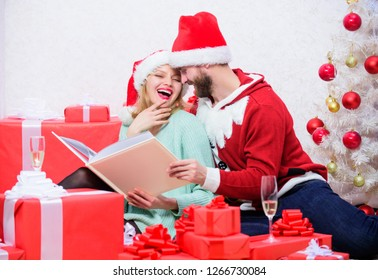 Celebrating new year together. Family tradition. Couple in love enjoy christmas. Happy flashback. Family cuddle near christmas tree while looking family photo album. Remember bright moments of year.