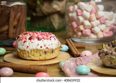 Celebrating plate with marshmallows, sweet cake, candies, fresh fruit tea, cinnamon on wooden table, birthday party, holiday family photo