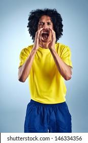 celebrating soccer player brazil team kit for world cup scoring goal and winning