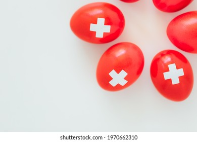 Celebrating Swiss National Holiday on August 1st with traditional eggs colored like swiss flag. Traditional brunch on the day of the Swiss Confederacy founding.