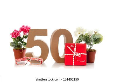 Celebrating your Fiftieth birthday, getting presents like reading glasses and a begonia