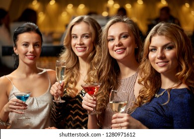 celebration, bachelorette party and holidays concept - happy women or female friends with non-alcoholic drinks in glasses at night club