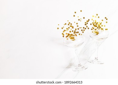 celebration background with glass of golden glitters, abstract drinking celebration concept. Top view with copy space.