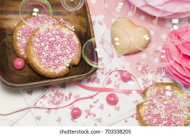 celebration the birth of a daughter with Dutch crisp bakes with pink sugared aniseed balls, muisjes,honeycomb, heart decorations, blow bubbles