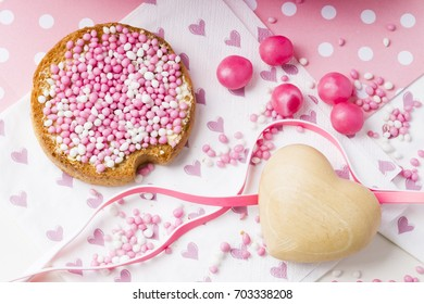 celebration the birth of a daughter with Dutch crisp bakes with pink sugared aniseed balls, muisjes honeycomb, heart decorations
