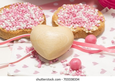 celebration the birth of a daughter with Dutch crisp bakes with pink sugared aniseed balls, honeycomb, heart decorations,