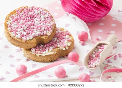 celebration the birth of a daughter with Dutch crispy biscuit with pink sugared aniseed balls, honeycomb, decorations