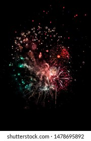 Celebration With Bright Colorful Fireworks Over Black Sky