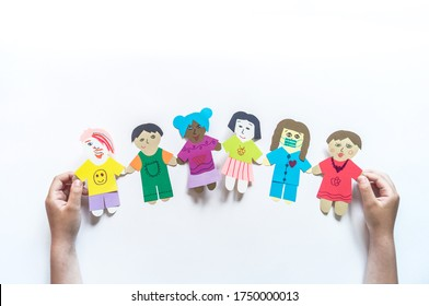 Celebration of bringing people together from all over the world Child makes a paper craft hands. Rainbow Flag Day. Nationality concept. Victory over the coronovirus pandemic.