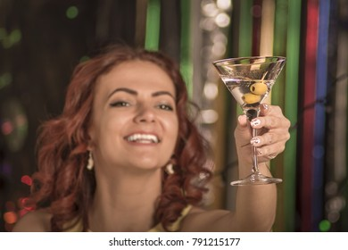 Celebration concept - Portrait of an Attractive woman with martini cocktail glass