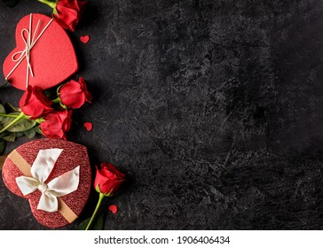 Celebration concept for Saint Valentines day or birthday with hearth shaped gift box and bouquets of red rose