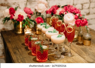 A celebration designed in pink colors with alcoholic drink complementing the party theme