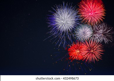 Celebration fireworks over night sky, copy space. Celebration colorful fireworks. New Year holidays salute. 4 of July,  4th of July, Independence Day beautiful fireworks.