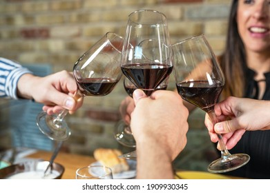 Celebration. Group of friends holding The Glasses Of Wine Making A Toast. High quality photo