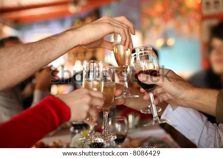 Celebration. Hands holding the glasses of champagne and wine making a toast. Shallow DOF.