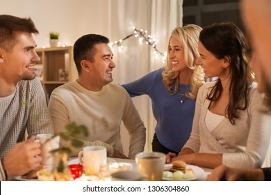 celebration, holidays and people concept - happy family or friends having tea party at home