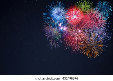 Celebration multicolored fireworks, copy space. 4 of July, 4th of July, Independence Day beautiful fireworks. Canada Day holidays salute. New Year celebration colorful fireworks.