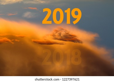 Celebration new year 2019 with sky and golden clouds, text with 2018 and 2019 with amazing cloudy sky at sunset