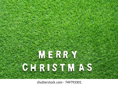 Celebration of New year and Christmas, Top view Christmas alphabet on green grass background