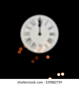CELEBRATION OF THE NEW YEAR, CLOCK UNFOCUSED AT TWELVE O'CLOK