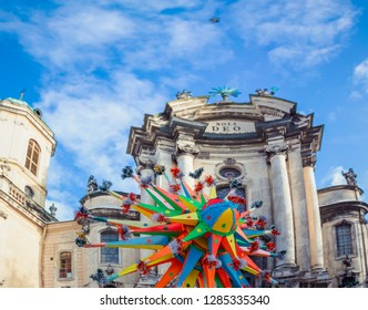 """Celebration of  Orthodox Christmas in Lviv. Festival """"The flash of Christmas star"""". Parade of Christmas stars. Christmas star on Dominican church background."""