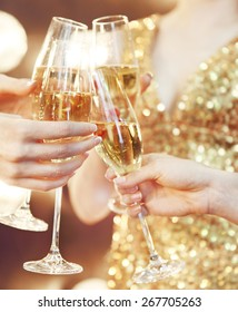 Celebration or party. People holding glasses of champagne making a toast