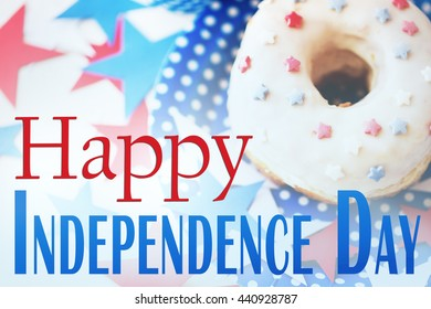 celebration, patriotism, anniversary and holidays concept - close up glazed sweet american donut with stars decoration on disposable plate at 4th july party from top with happy independence day words