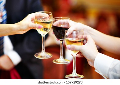 Celebration. People holding glasses of alcohol making a toast
