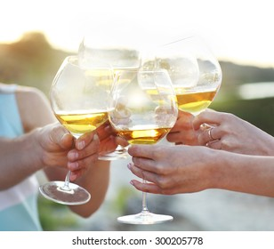 Celebration. People holding glasses of red wine making a toast