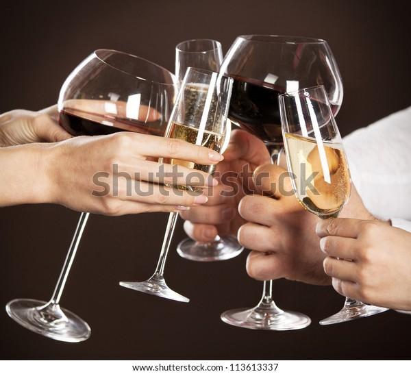 Celebration. People holding glasses of white wine making a toast