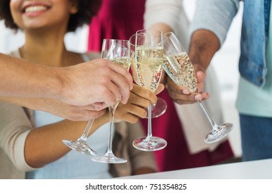 celebration, people and holidays concept - close up of happy friends clinking glasses of champagne at party