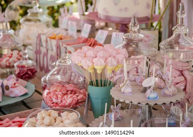celebration table with sweets and candies