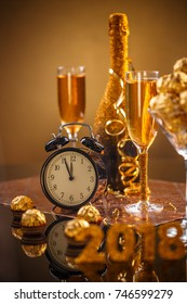 Celebration theme with champagne, chocolate and clock